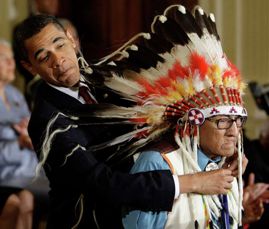 President Barack Obama bestows a Presidential Medal of Freedom on Chief Joseph Medicine Crow during a White House ceremony in 2009. Photo: Alex Brandon, STF / AP