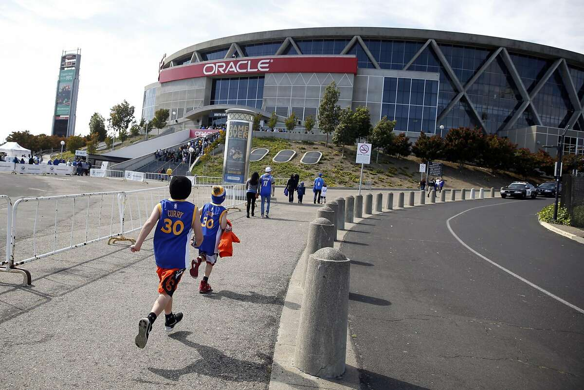 Fans arrive to Oracle Arena for Golden State Warriors' game against the Portland Trailblazers in Oakland, Calif., on Sunday, April 3, 2016.