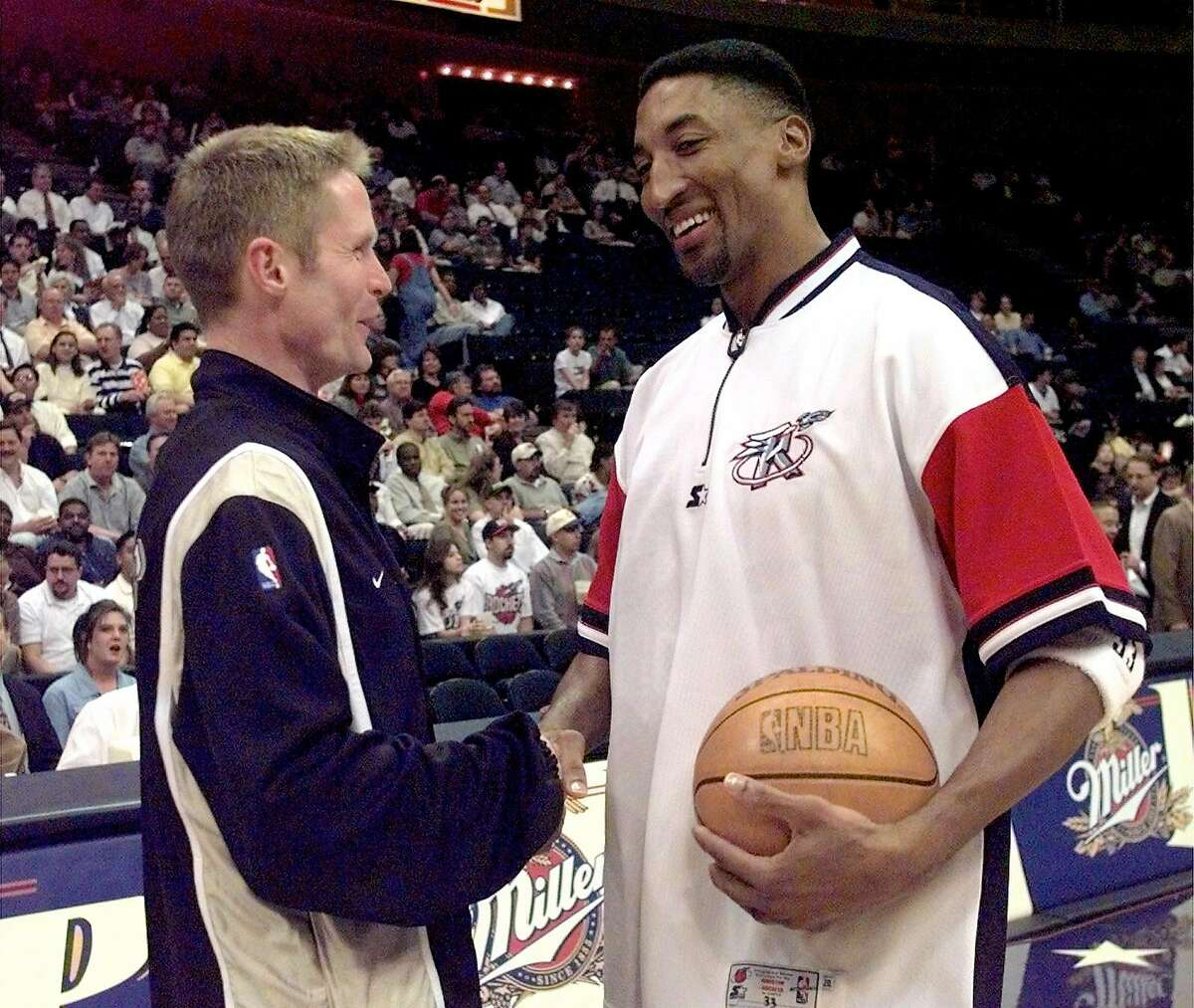 Spur Steve Kerr, right and Scottie Pippen of the Rockets both former Chiago Bulls teammates last season greet one another prior to their preseason game in Houston Tues. Jan. 26, 1998.