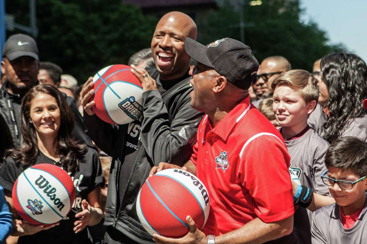 Former Houston Rocket Kenny Smith shares a laugh with Mayor Sylvester Turner on Sunday before the NCAA Final Four Dribble event, in which children dribbled basketballs from City Hall to the George R. Brown Convention Center.