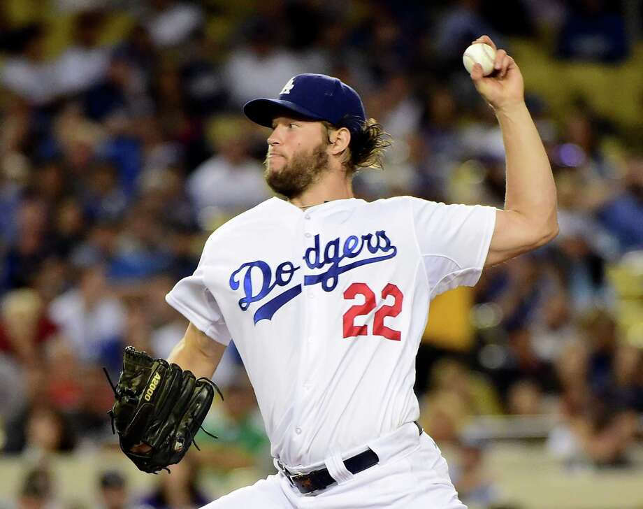 Dodgers ace Clayton Kershaw qualifies as a workhorse these days, although his 2322/3 innings in 2015 were the lowest MLB-leading total in a non-strike year. Photo: Harry How, Staff / 2015 Getty Images