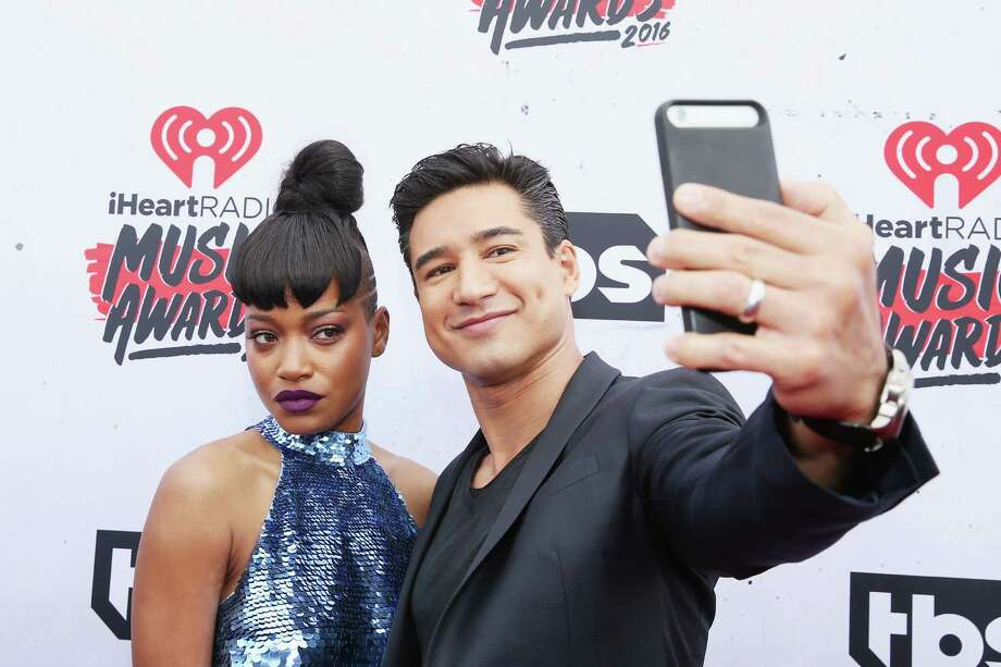 INGLEWOOD, CALIFORNIA - APRIL 03: Actress Keke Palmer (L) takes a selfie with TV personality Mario Lopez atthe iHeartRadio Music Awards at The Forum on April 3, 2016 in Inglewood, California. Photo: Jonathan Leibson, Getty Images / 2016 Getty Images