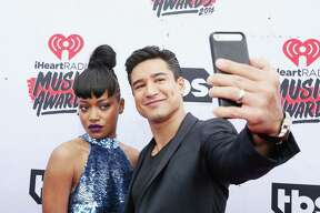 INGLEWOOD, CALIFORNIA - APRIL 03: Actress Keke Palmer (L) takes a selfie with TV personality Mario Lopez atthe iHeartRadio Music Awards at The Forum on April 3, 2016 in Inglewood, California.