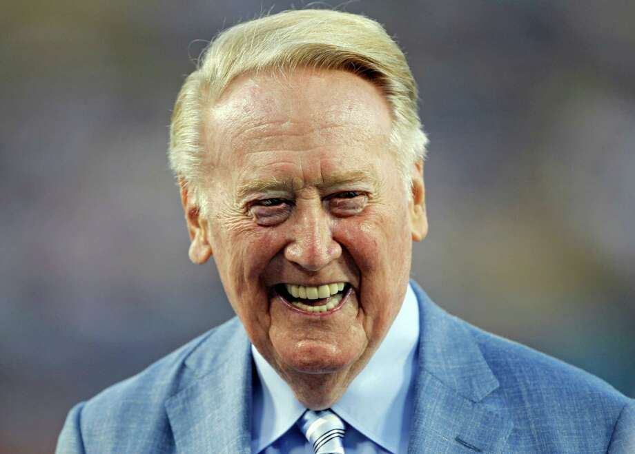 In this photo taken Sept. 23, 2015, Los Angeles Dodgers broadcaster Vin Scully is honored before a baseball game against the Arizona Diamondbacks in Los Angeles.The 88-year-old Hall of Fame broadcaster heads into his 67th and final season in the booth. He plans to work opening day in San Diego and all 81 home games in 2016. (AP Photo/Alex Gallardo) Photo: Alex Gallardo, FRE