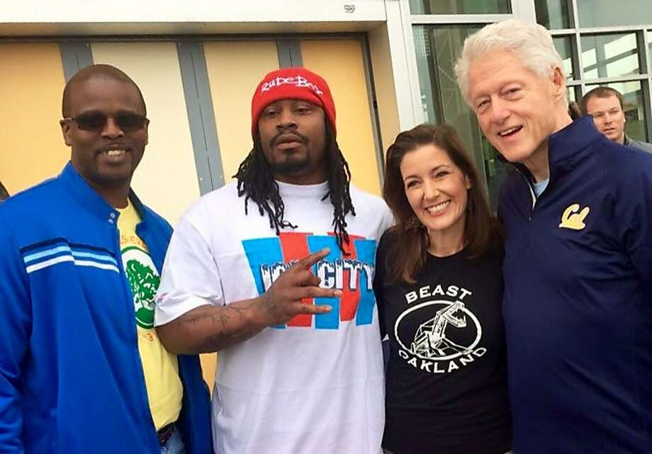 Superintendent Antwan Wilson, former Oakland student and NFL player Marshawn Lynch, Mayor LIbby Schaaf and former President Bill Clinton attend a day of action at the Havenscourt-Lockwood campus in Oakland. Photo: Oakland Unified School District