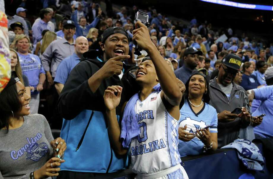 North Carolina's Nate Britt, right, and Villanova's Kris Jenkins, who are brothers in every way except blood, will play against each other in Monday's title game. Photo: Matt Rourke, STF / AP