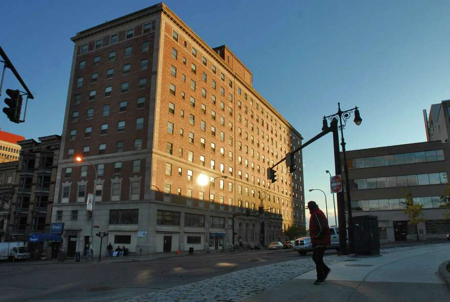A pedestrian walks on State Street across from the DeWitt Clinton building, center,  in Albany , NY on Tuesday evening October 13, 2009. FOR CHRIS CHURCHILL STORY.(Philip Kamrass / Times Union) Photo: PHILIP KAMRASS