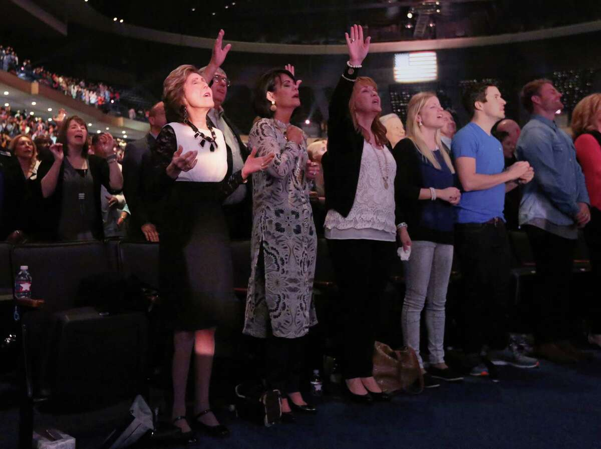 Dodie Osteen, front left, regularly leads prayer services and drive-by healing sessions at Lakewood Church.