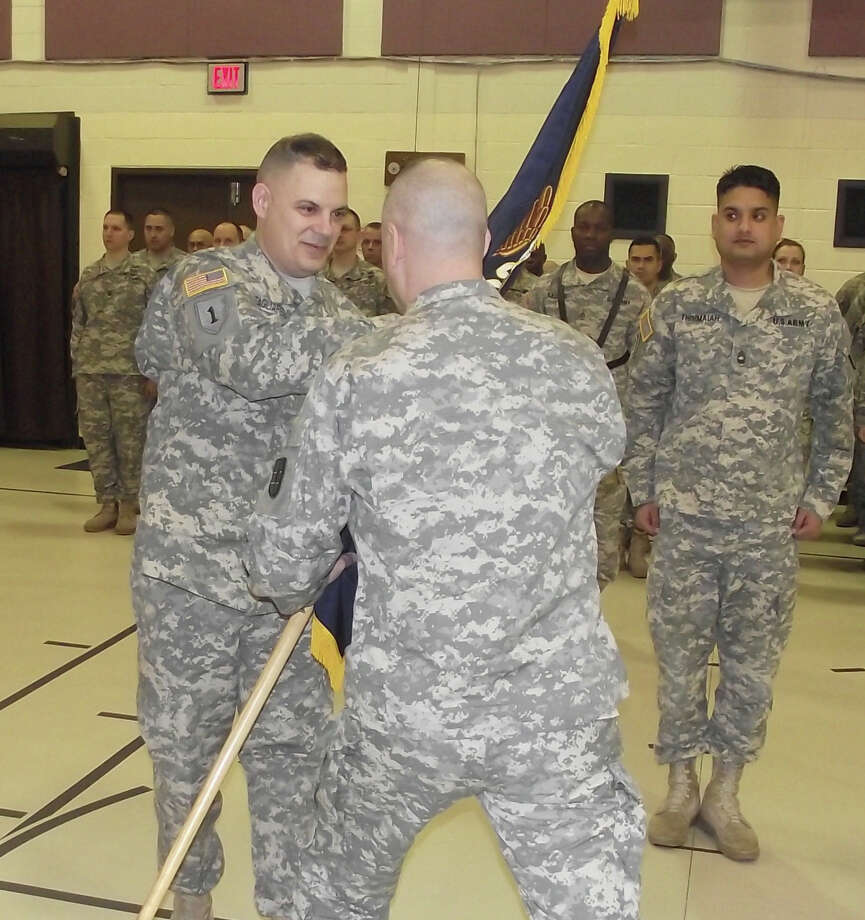 Division of Military and Naval Affairs New York Army National Guard Lt. Col. Michael Tagliaferro accepts the unit flag of the 2nd Battalion, 106th Regiment during change-of-command ceremony.