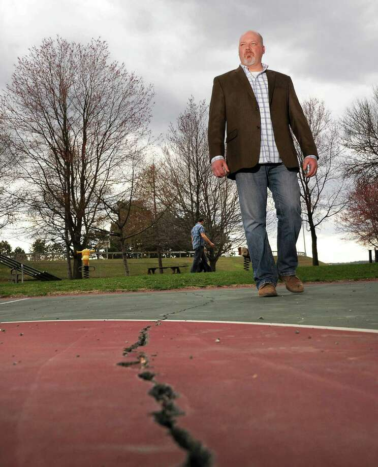 Assistant director Michael Brown of the office of planning and development inspects damage to the basketball courts at Riverfront Park Friday April 1, 2016 in Rensselaer, NY.  (John Carl D'Annibale / Times Union) Photo: John Carl D'Annibale / 10036051A