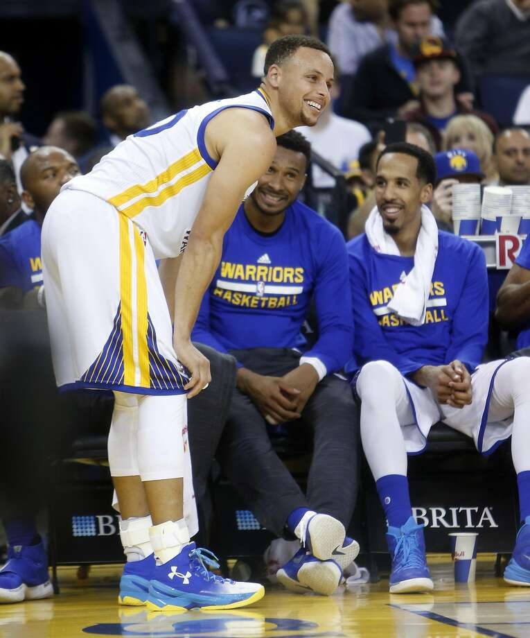 Golden State Warriors' Stephen Curry, Leandro Barbosa and Shaun Livingston share a laugh during 2nd quarter stoppage of play against Portland Trail Blazers in NBA game at Oracle Arena in Oakland, Calif., on Sunday, April 3, 2016. Photo: Scott Strazzante, The Chronicle