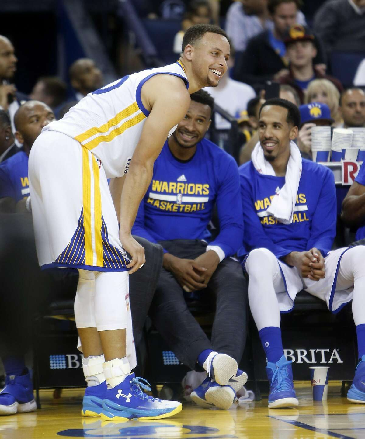 Golden State Warriors' Stephen Curry, Leandro Barbosa and Shaun Livingston share a laugh during 2nd quarter stoppage of play against Portland Trail Blazers in NBA game at Oracle Arena in Oakland, Calif., on Sunday, April 3, 2016.