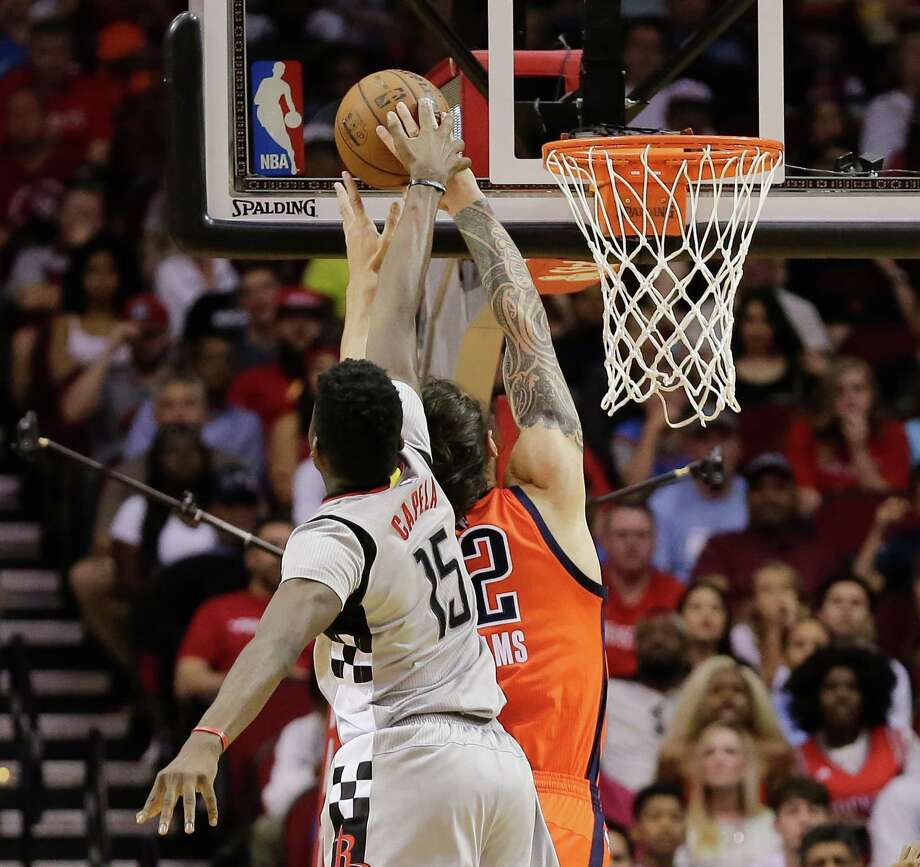 Rockets center Clint Capela (15) swoops in from behind to block a shot by Oklahoma's Steven Adams. Photo: Bob Levey, FRE / FR156786 AP