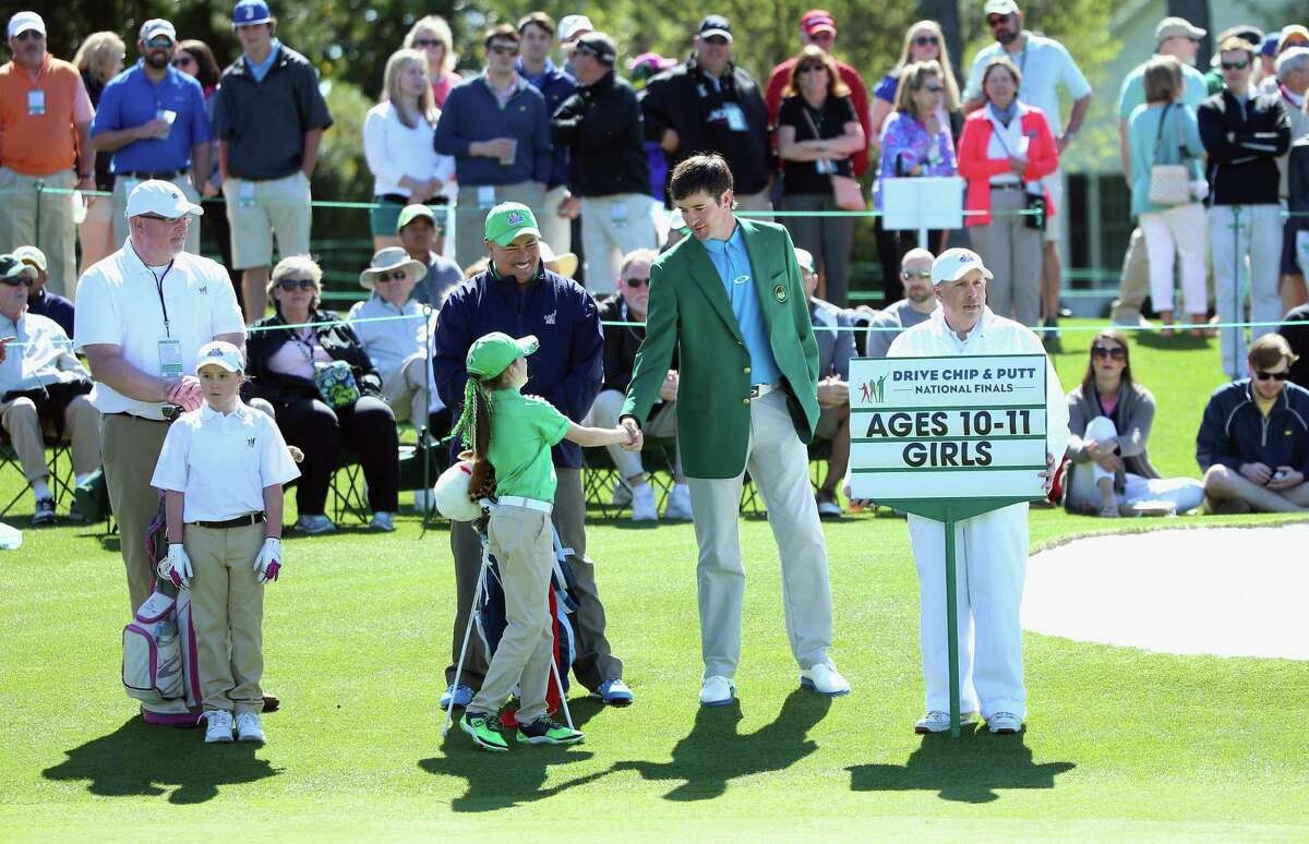 AUGUSTA, GEORGIA - APRIL 03: Nicole Criscone, competing in the 10-11 Girls category, shakes hands with two-time Masters champion Bubba Watson during the Drive, Chip and Putt Championship at Augusta National Golf Club on April 3, 2016 in Augusta, Georgia. (Photo by Andrew Redington/Getty Images) ORG XMIT: 597243995