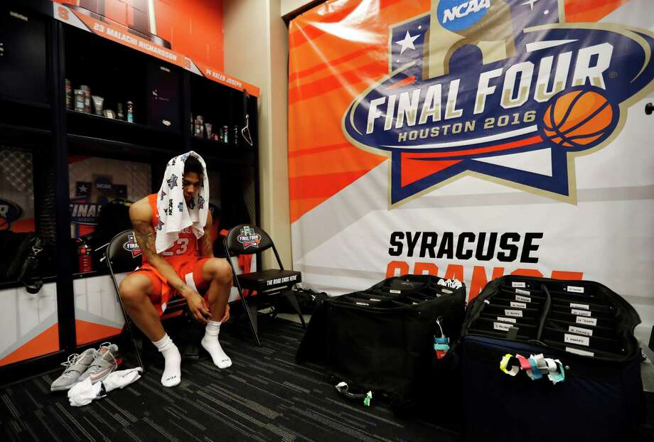 Syracuse's Malachi Richardson (23) sits in the locker room after the NCAA Final Four tournament college basketball semifinal game against North Carolina, Saturday, April 2, 2016, in Houston. North Carolina won 83-66. (AP Photo/Eric Gay)  ORG XMIT: FF197 Photo: Eric Gay / AP