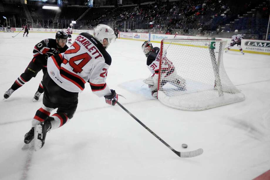 Reece Scarlett of the Albany Devils brings the puck around his net in their game against the Binghamton Senators on Sunday, April 3, 2016, in Albany, N.Y.   (Paul Buckowski / Times Union) Photo: PAUL BUCKOWSKI / 10035988A