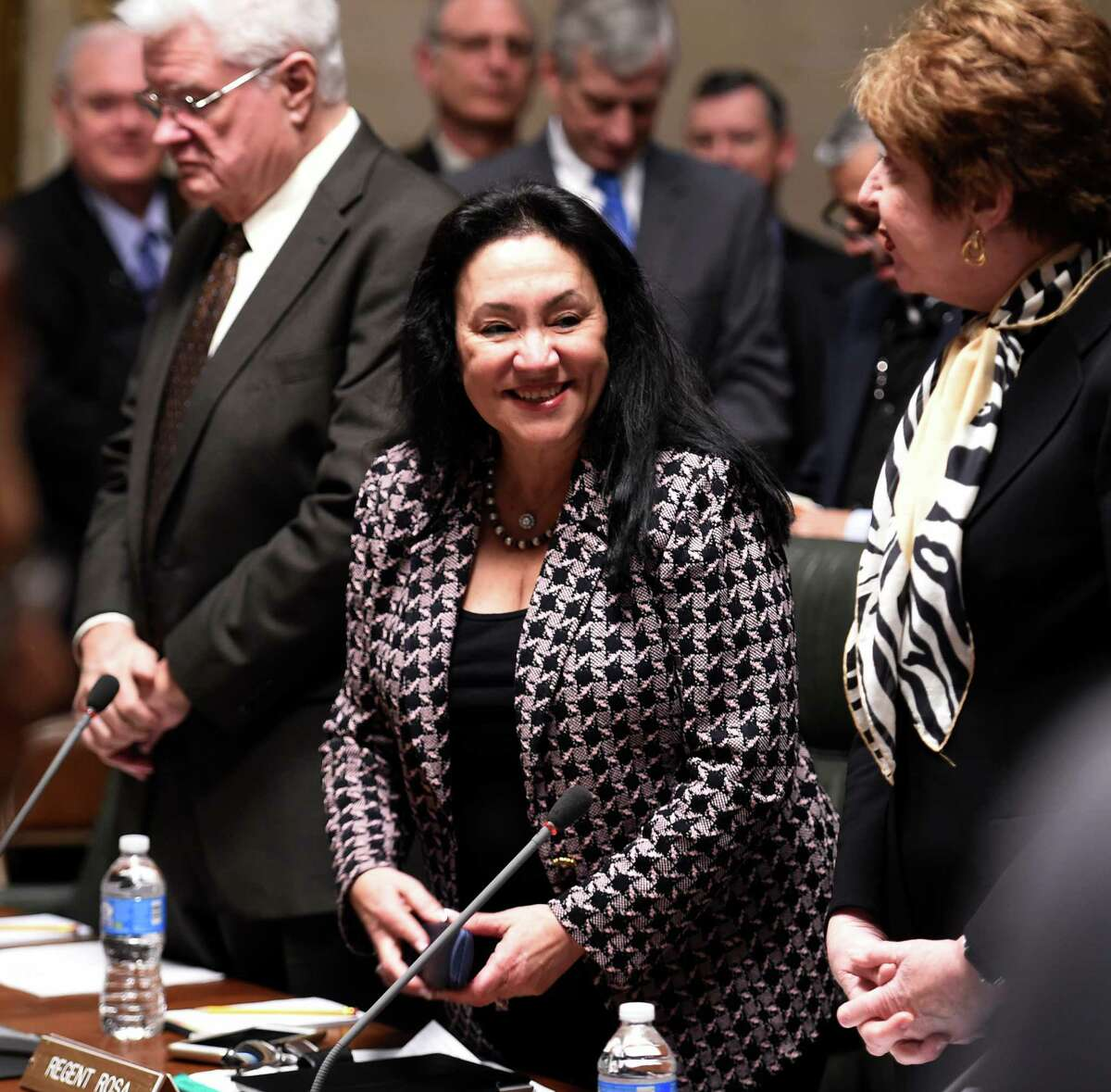 Betty Rosa, center, reacts after being named Chancellor elect of the New York State Board of Regents during meeting held on Monday, March 21, 2016, at the Education Department building in Albany, N.Y. Rosa will take office on April 1st replacing Merryl H. Tisch. (Skip Dickstein/Times Union)