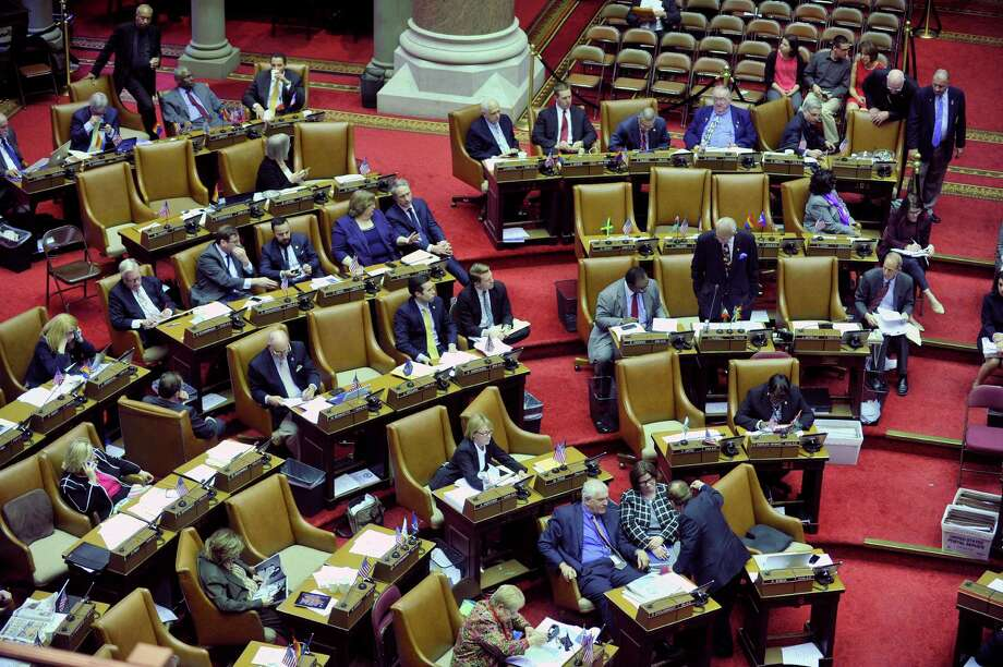 Members of the New York State Assembly work at their desks at the Capitol on Thursday, March 31, 2016, in Albany, N.Y.  (Paul Buckowski / Times Union) Photo: PAUL BUCKOWSKI / 10036040A