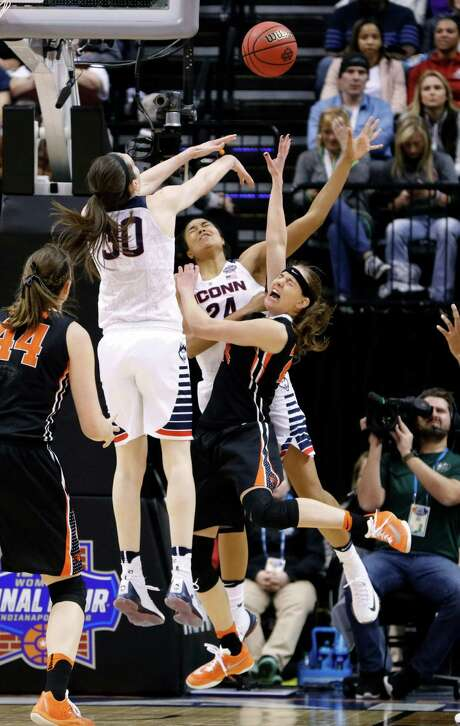 A bid by Oregon State's Sydney Wiese, right, to score against Connecticut's Breanna Stewart, left, and Napheesa Collier has a painful conclusion. Photo: AJ Mast, FRE / FR123854 AP