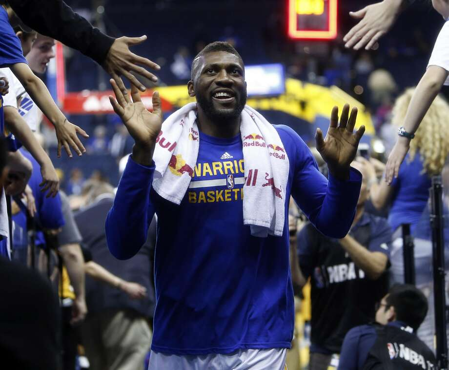 Golden State Warriors' Festus Ezeli smiles as he leaves the court  after Warriors' 136-111 win over Portland Trail Blazers in NBA game at Oracle Arena in Oakland, Calif., on Sunday, April 3, 2016. Photo: Scott Strazzante, The Chronicle