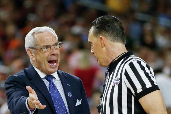 North Carolina coach Roy Williams takes umbrage with an official's call in Saturday's  83-66 win over Syracuse that put the Tar Heels in tonight's title game against Villanova.
