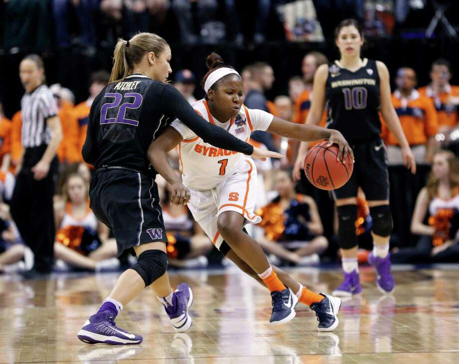 Syracuse's Alexis Peterson (1) is defended by Washington's Alexus Atchley (22) during the second half of a national semifinal game at the women's Final Four in the NCAA college basketball tournament Sunday, April 3, 2016, in Indianapolis. Syracuse won 80-59. (AP Photo/AJ Mast) ORG XMIT: NAF204 Photo: AJ Mast / FR123854 AP