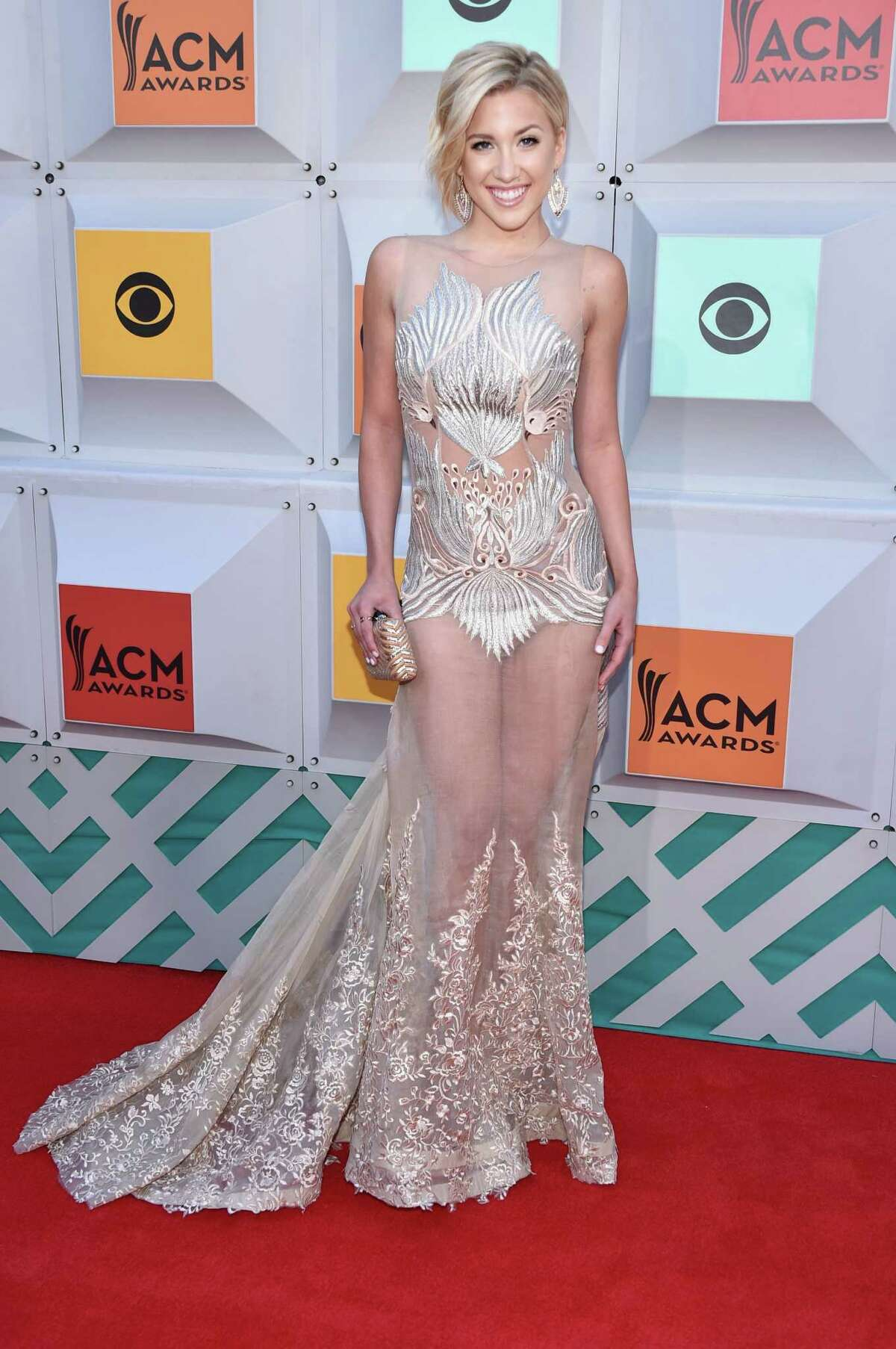 Best: Savannah Chrisley Look, the naked dress will never die, so let's just succumb already. The TV personality does look amazing, nothing inappropriate is happening - naked dress success.