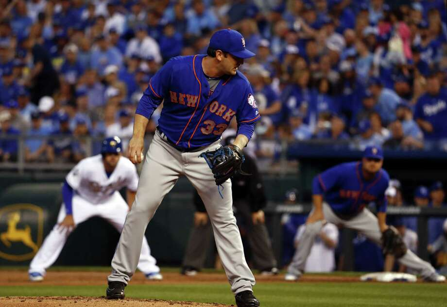 KANSAS CITY, MO - APRIL 03:  Starting pitcher Matt Harvey #33 of the New York Mets looks over his shoulder at Mike Moustakas #8 of the Kansas City Royals leading off first base during the second inning of the opening day game at Kauffman Stadium on April 3, 2016 in Kansas City, Missouri. (Photo by Jamie Squire/Getty Images) ORG XMIT: 607674553 Photo: Jamie Squire / 2016 Getty Images