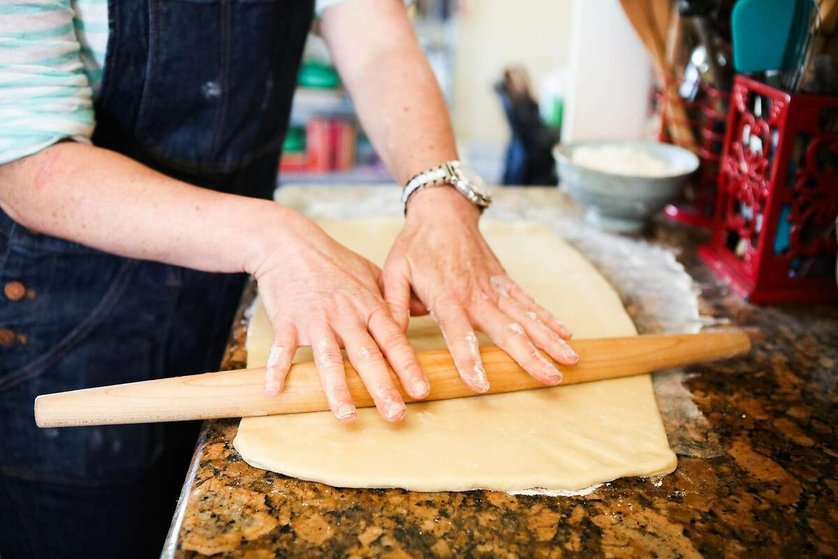 Brooke Mosley, the pastry chef at Outerlands restaurant, rolls dough to make sticky buns.