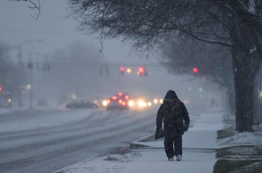 So much for spring. Snow was accumulating in Colonie early Monday morning, leaving the region with a thin layer of snow that threatened to slow the morning commute. (Skip Dickstein / Times Union)