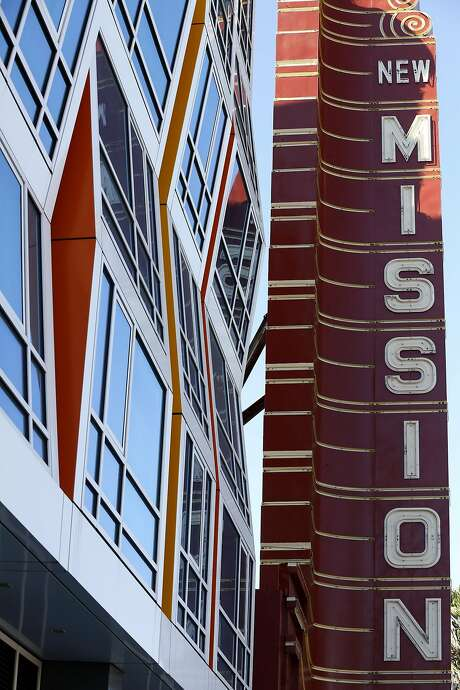 The New Mission Theater, below, and adjacent condo complex are part of the area's ever-changing face. Photo: Connor Radnovich, The Chronicle