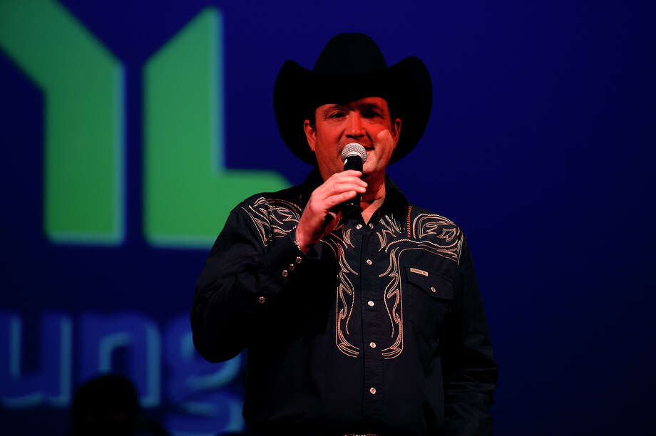 Tracy Byrd, a country music star and Southeast Texas native, introduces Neal McCoy  during a benefit concert for Young Life Southeast Texas, a Christian youth organization, at the Jefferson Theatre on Saturday night. The concert was a kickoff for a month of fundraising events for the organization, for which Byrd is a local board member. Byrd said his first public performance was at the Jefferson Theatre. Photo taken Thursday 3/31/16 Ryan Pelham/The Enterprise Photo: Ryan Pelham / ©2016 The Beaumont Enterprise/Ryan Pelham