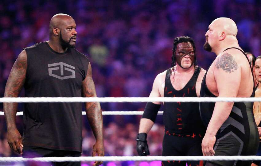 IMAGE DISTRIBUTED FOR WWE - NBA legend Shaquille O'Neal, left, faces off with WWE superstar The Big Show at WWE WrestleMania 32 at AT&T Stadium on Sunday, April 3, 2016, in Arlington, Texas.