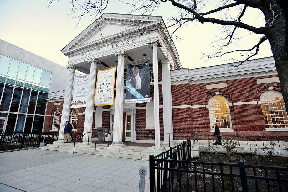 The main building of the Ferguson Library is seen in Stamford, Conn., on Sunday, Dec. 7, 2014. The main building of the library was dedicated in the honor of the former president, Ernest DiMattia Jr. Photo: Jason Rearick / Jason Rearick / Stamford Advocate
