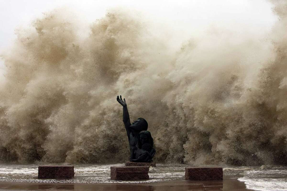 """Waves crash into the seawall as Hurricane Ike began to hit Galveston on Sept. 12, 2008. Though not a """"direct hit,"""" Ike was linked to three dozen deaths and caused $14 billion in damage."""