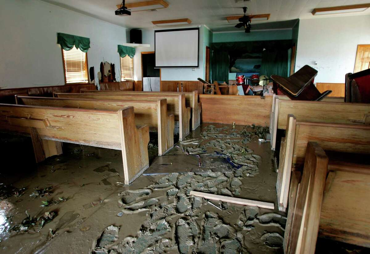 Storm surge caused by Hurricane Ike in September 2008 flooded the Oak Island Baptist Church in Anahuac, leaving furniture tossed throughout the building and inches of mud behind.