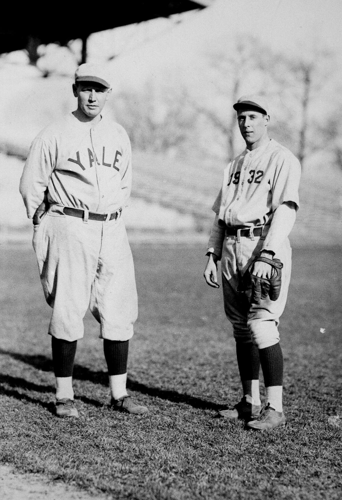 Albie Booth, right, Yale's diminutive football flash, in a different uniform for baseball practice, March 26, 1930.