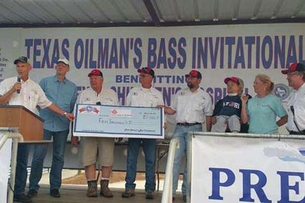 The TOBI Board od Directors presenting a $50,000 check to Texas Childrens Hospital photo courtesy TOBI