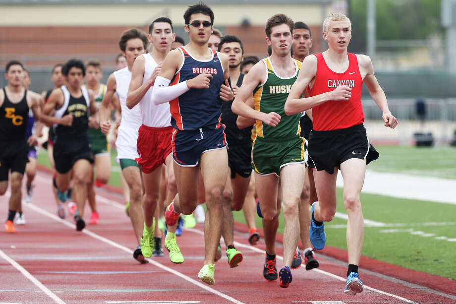 New Braunfels Canyon's Sam Worley (from right) runs ahead of Holmes' Chris Myers and Brandeis' Beau Anderson during Judson's Ron Faught Invitational at Rutledge Stadium on March 21, 2015. Photo: Marvin Pfeiffer /San Antonio Express-News / Express-News 2015