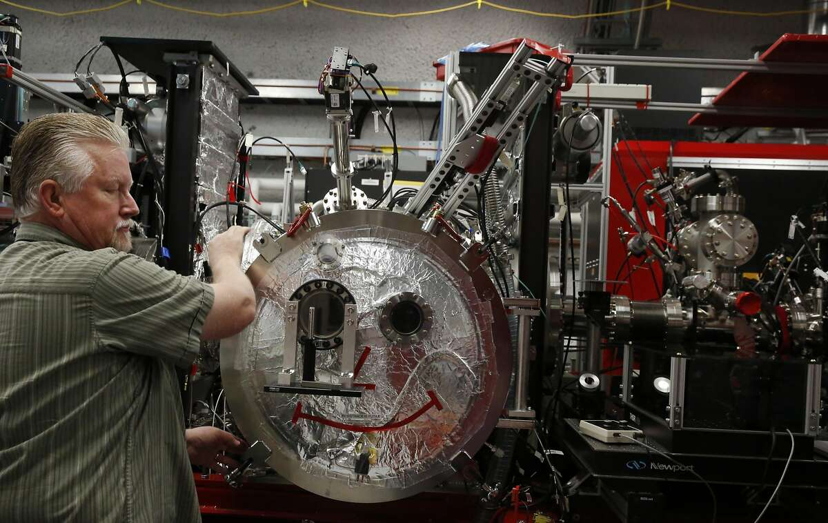 Matt Hayes, area manager for the instrument, looks over the x-ray while he and colleagues set up a jet to inject particles for an experiment with the LINAC Coherent Light Source at SLAC National Accelerator Laboratory March 30, 2016 in Menlo Park, Calif.
