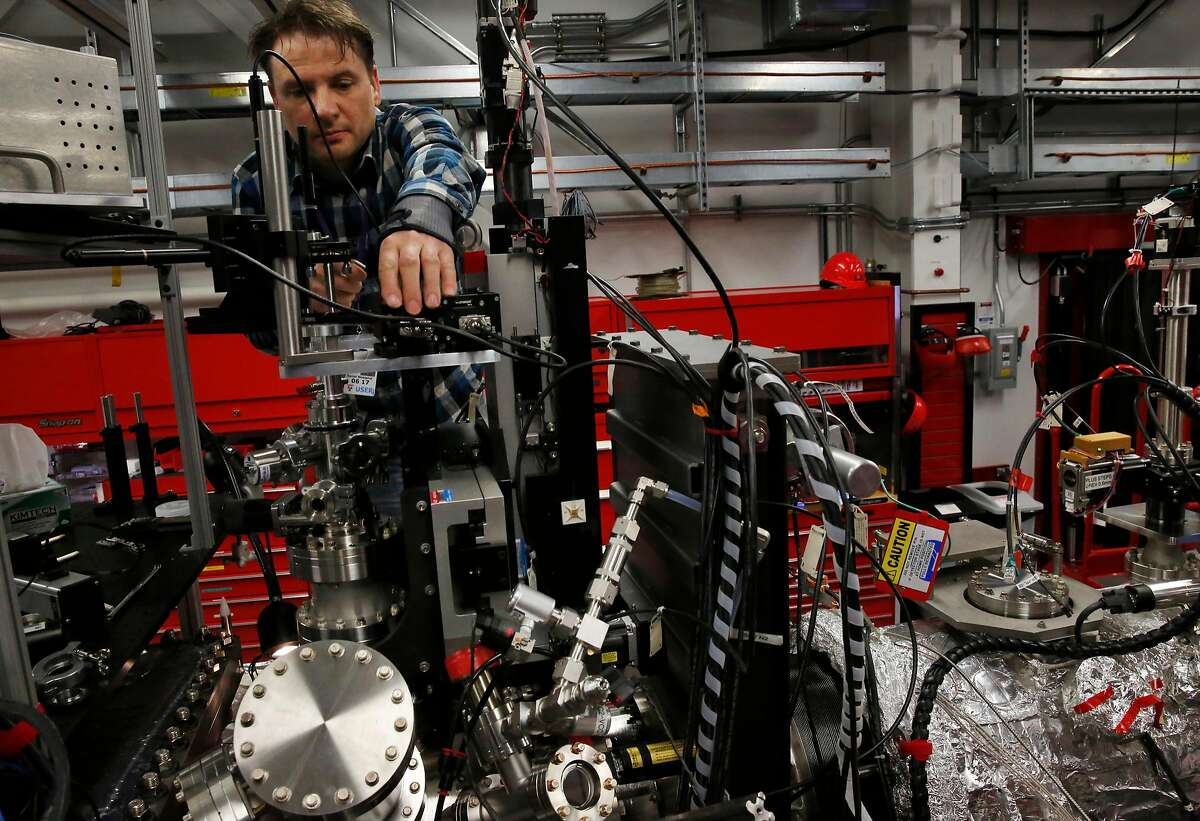 Research engineer Daniel Westphal sets up a jet to inject particles into the x-ray beam for an experiment with the LINAC Coherent Light Source at SLAC National Accelerator Laboratory March 30, 2016 in Menlo Park, Calif.