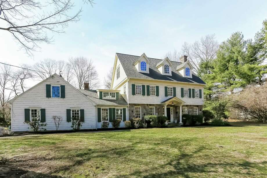 With its proximity to town, local beaches and Darien's Blue Ribbon elementary school, the classic five-bedroom colonial at 11 Harbor Road is all about location, location, location. Photo: Darien News / Contributed Photo / Darien News
