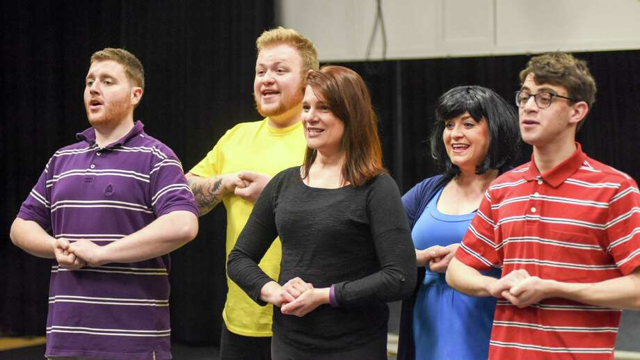 "Darien Arts Center Stage is rehearsing Clark Gesner's ""You're a Good Man, Charlie Brown,"" a family-friendly production, opening April 22. The light-hearted show is a collection of short scenes and songs based on the 'Peanuts' comic strip, originally created by Charles M. Schulz in 1967. Pictured are Billy Schubeck as Schroeder, Matthew Casey as Charlie Brown, Jenifer Condon as Sally Brown, Melinda Zupaniotis as Lucy Van Pelt and Noam Ben Yakir as Linus Van Pelt. Photo: Darien News / Contributed Photo / Darien News"