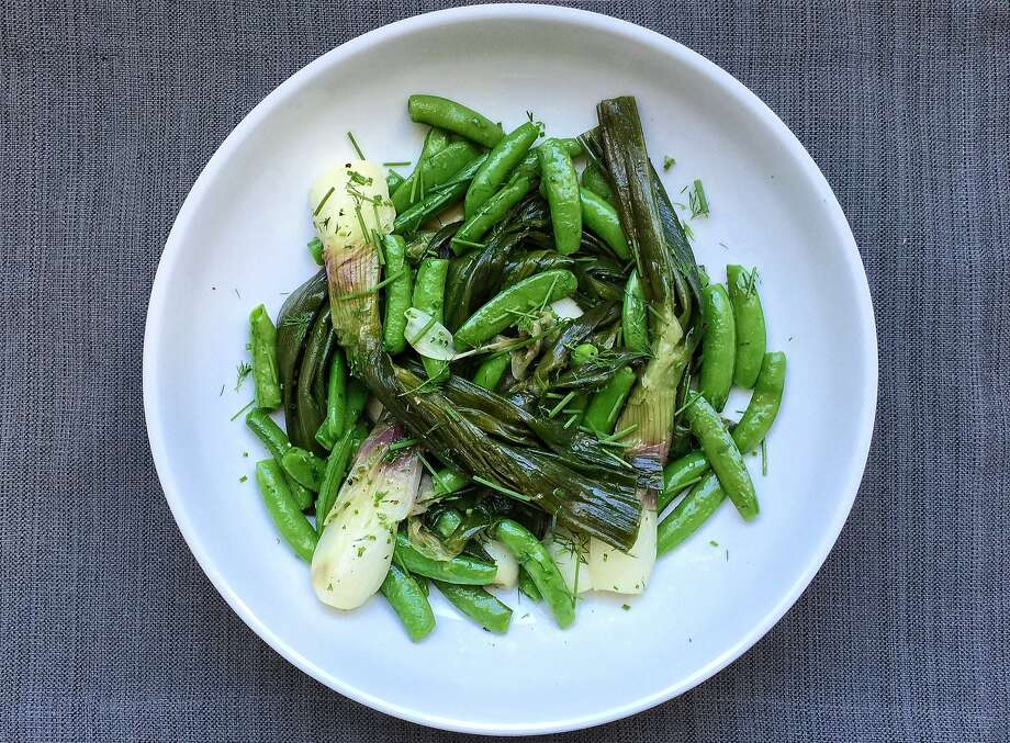 Braised spring onions with snap peas, dill and chives Photo: Amanda Gold