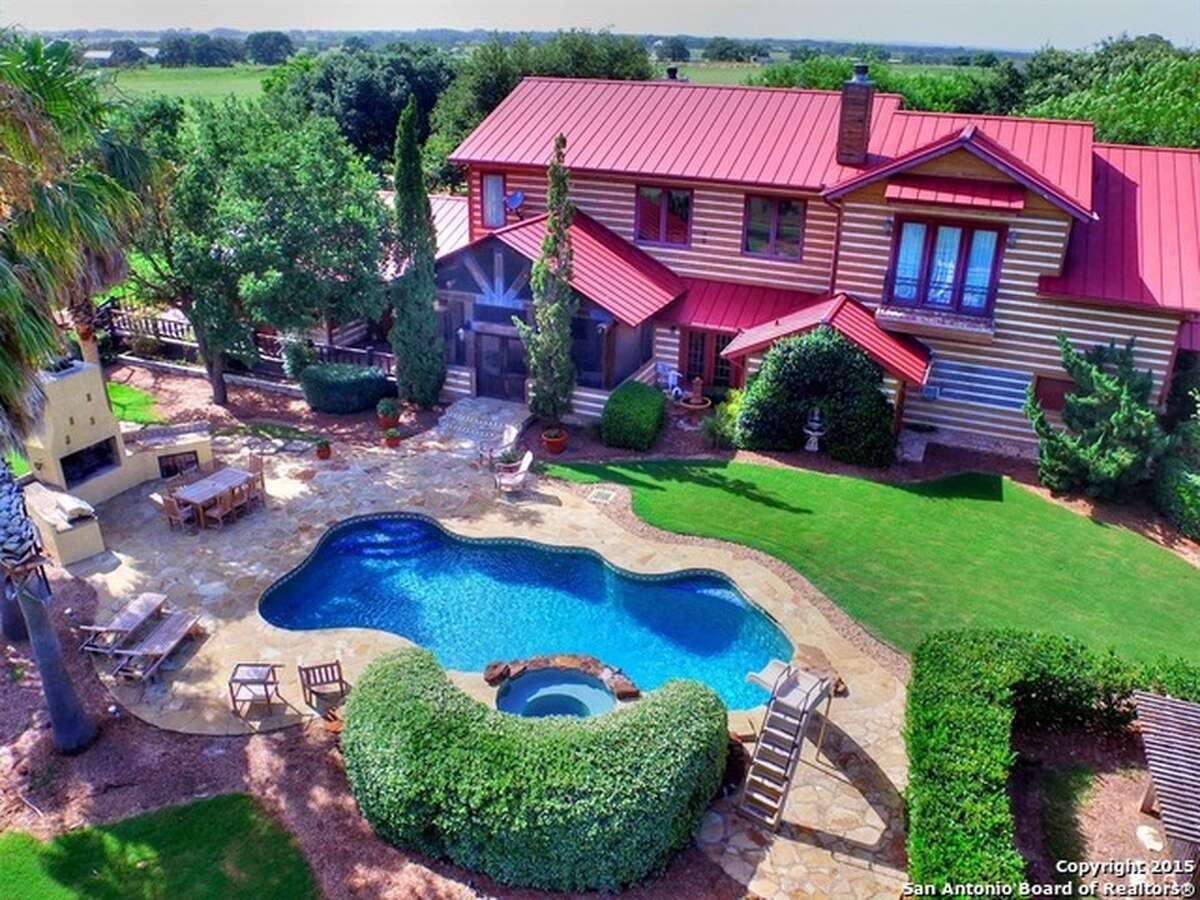 The 5 bed, 5 bath 5,068-square-foot home on 192.16 acres at 1770 County Road 305, in Floresville, includes a basement wine cellar with bar/lounge, a tornado room and a fireplace in the master suite. The property includes 2 cabins, a barn, a separate house, a pond with and island and pier, an in-ground swimming pool, and aviary and many separate horse features.