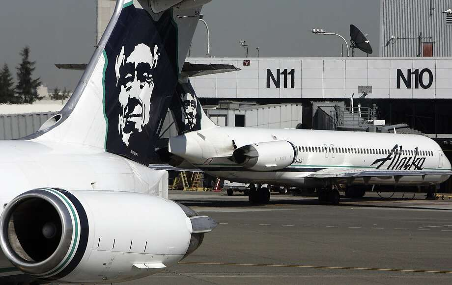 (FILES) This file photo taken on September 25, 2006 shows Alaska Airlines planes at Seattle-Tacoma International Airport.  Alaska Airlines parent company Alaska Air Group said on April 4, 2016 it was acquiring Virgin America in a friendly takeover worth around $4 billion including debt to create the US's fifth-largest airline.A definitive merger agreement had been unanimously approved by the boards of both companies, it said in a statement.  / AFP PHOTO / GABRIEL BOUYSGABRIEL BOUYS/AFP/Getty Images Photo: GABRIEL BOUYS, AFP/Getty Images