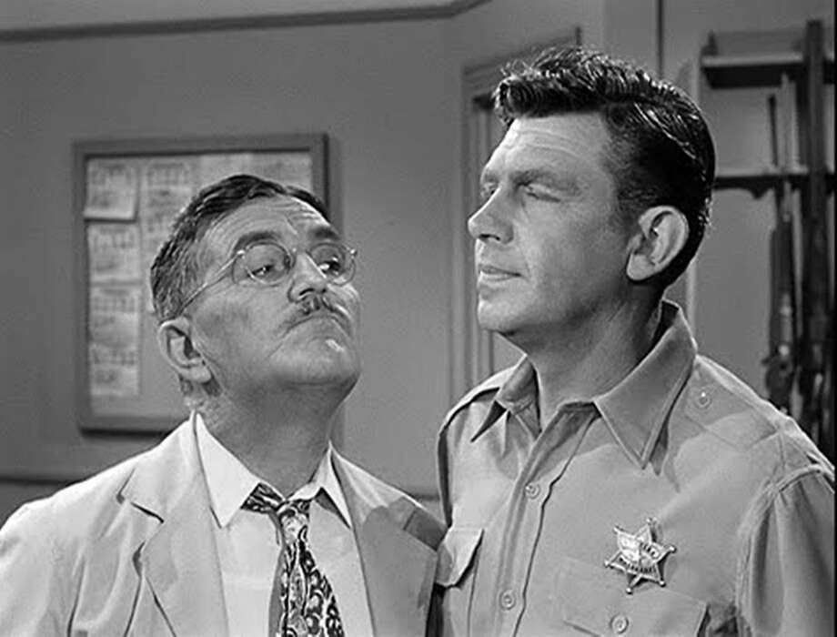 """L-R: Howard McNear as barber Floyd Lawson and Andy Griffith as Sheriff Andy Taylor in """"The Andy Griffith Show."""" Photo courtesy of Parmount Home Video. Photo: Paramount Home Video"""