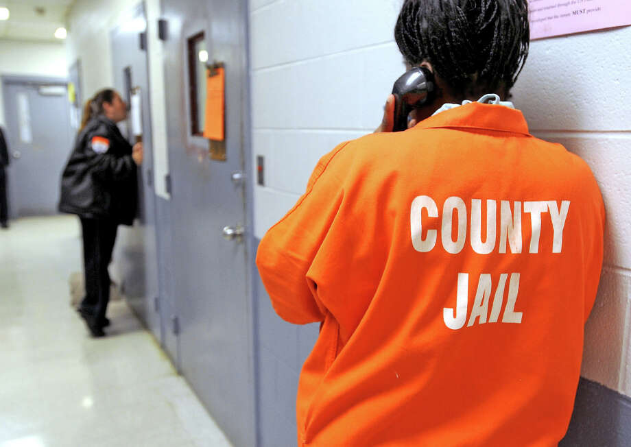 An inmate makes a phone call from the Jefferson County Jail in 2011.  Guiseppe Barranco/The Enterprise Photo: GUISEPPE BARRANCO / B