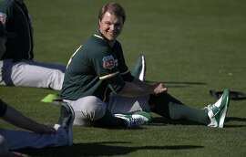 Pitcher Sonny Gray, 54 begins the day with stretches during spring training workouts for the Oakland Athletics at the Lew Wolff Training Complex in Mesa, Arizona on Thurs. February 25, 2016.