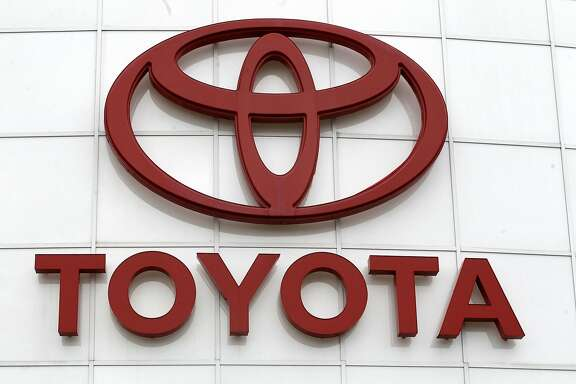 """FILE - In this March 30, 2011 file photo, the Toyota logo is shown at Wilsonville Toyota, in Wilsonville, Ore.  Toyota announced Monday, April 4, 2016, that it is forming a new data science company in partnership with Microsoft that's designed to free customers """"from the tyranny of technology."""" The company called Toyota Connected has a goal of simplifying technology so it's easier to use. (AP Photo/Rick Bowmer, File)"""